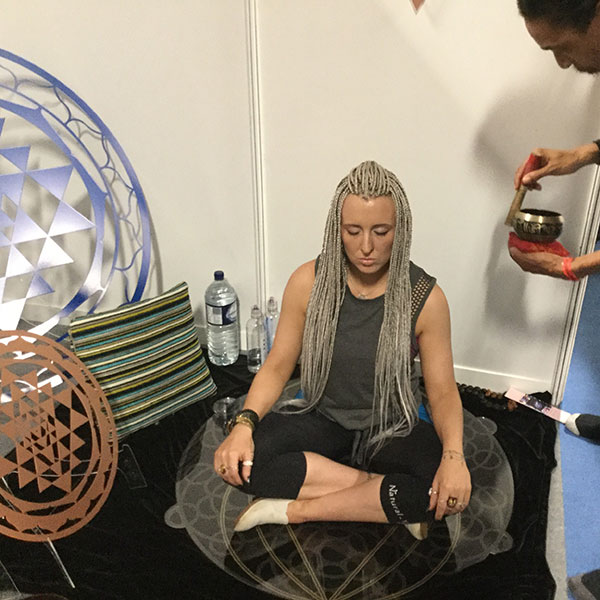 Om Yoga Show in Manchester 2018. Lee our Healer working with clients to show them how effective the resonance plates are. The client is sitting on a Universal DNA that has been tachyonised