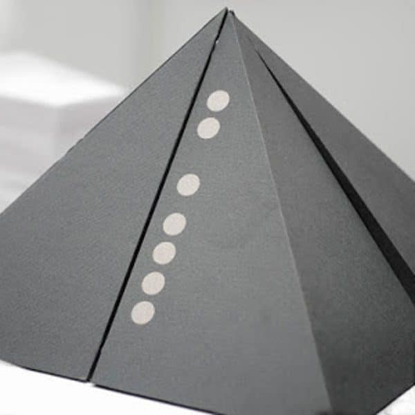 The outer packaging of the Resonance Chakra Alignment Plates and Creams. The pyramid mimics The Great pyramid in Giza.